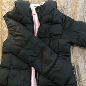 Black puffer jacket with pink fleece lining